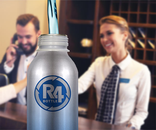 Complimentary Aluminum R4 Bottles Given Out at Hotel Reception Desk for Self-Serve Hydration Stations.